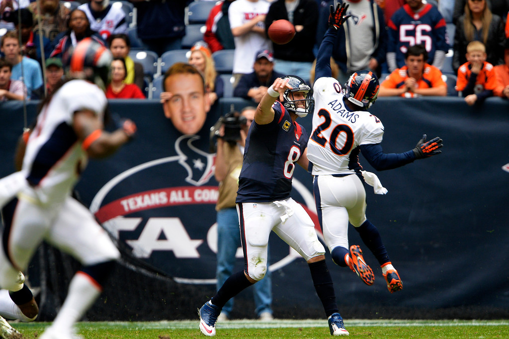 . Strong safety Mike Adams #20 of the Denver Broncos pressures quarterback Matt Schaub #8 of the Houston Texans at Reliant Stadium December 22, 2013 Houston, Texas. (Photo By Joe Amon/The Denver Post)