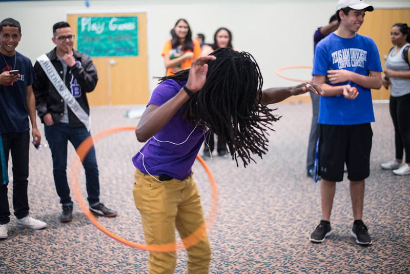 Chris Tucker showcases his skills during a hula hoop competition at the Homecoming Tip-Off Picnic.