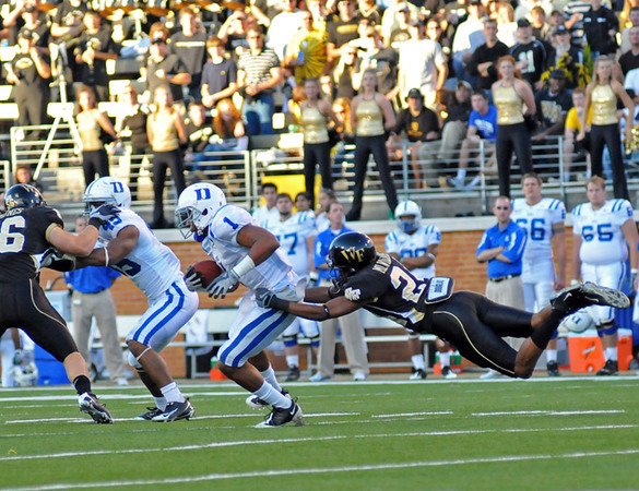 Michael Williams tackles Marshall.jpg