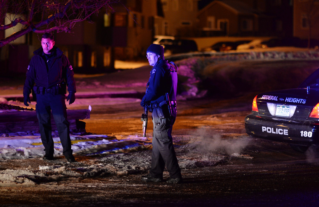 . THORNTON, CO. FEBRUARY 07: Police officers secure View Point Condominiums near the corner of Zuni St. and W. 103rd Ave. Thornton. Colorado. February 07. 2014. A SWAT team and other law-enforcement officers have surrounded a residence in Thornton after shots were fired during a homicide investigation. (Photo by Hyoung Chang/The Denver Post)