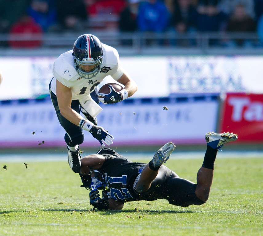 . Taylor McHargue #16 of the Rice Owls dives over Christi Spears #21 of the Air Force Falcons during the Bell Helicopter Armed Forces Bowl on December 29, 2012 at Amon G. Carter Stadium in Fort Worth, Texas.  (Photo by Cooper Neill/Getty Images)