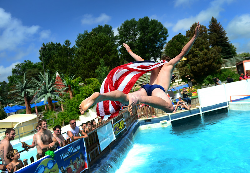. Joey Scherbarth flies through the air in an attempt at the perfect bell flop during the 18th annual Hyland Water World Belly Flop splashdown  in Thornton, CO on June 12, 2014. The event, sponsored by Hyland Hills Water World and Colleges in Colorado pitted bellyfloppers for a grand prize of a $1000 scholarship, a new laptop and free concert tickets.  Hyland Hills Water World is  the nation�s largest family water park featuring 48 attractions on 70 acres.  The college age students that participated took turns competing for the most impressive stomach flops at two different heights into Water World�s Calypso Cove pool. (Photo By Helen H. Richardson/ The Denver Post)