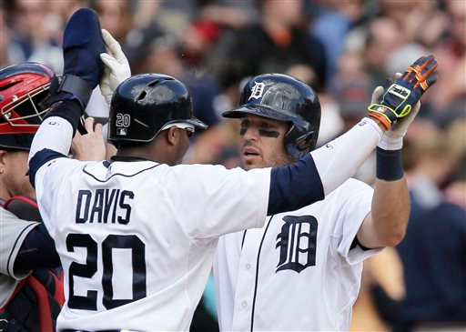 . Detroit Tigers\' Ian Kinsler, right, is greeted at home play by Rajai Davis (20) after hitting a two-run home run against the Cleveland Indians during the seventh inning of a baseball game Sunday, Sept. 14, 2014, in Detroit. (AP Photo/Duane Burleson)