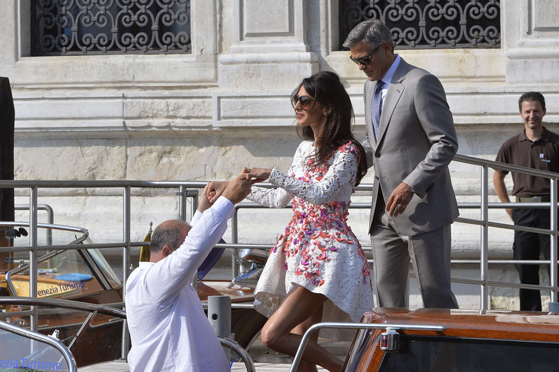 """. US actor George Clooney and his wife Amal Alamuddin board a taxi boat the Aman Hotel on September 28, 2014 in Venice. Hollywood heartthrob George Clooney and Lebanese-British lawyer Amal Alamuddin married in Venice on Saturday September 27, 2014 before partying the night away with their A-list friends in one of the most high-profile celebrity weddings in years. \""""George Clooney and Amal Alamuddin were married today (September 27) in a private ceremony in Venice, Italy,\"""" Clooney spokesman Stan Rosenfield said. The announcement came as a surprise as the pair were not expected to officially tie the knot until Monday, though they are still tipped for a civil ceremony at the town hall to make the marriage official under Italian law.   ANDREAS SOLARO/AFP/Getty Images"""