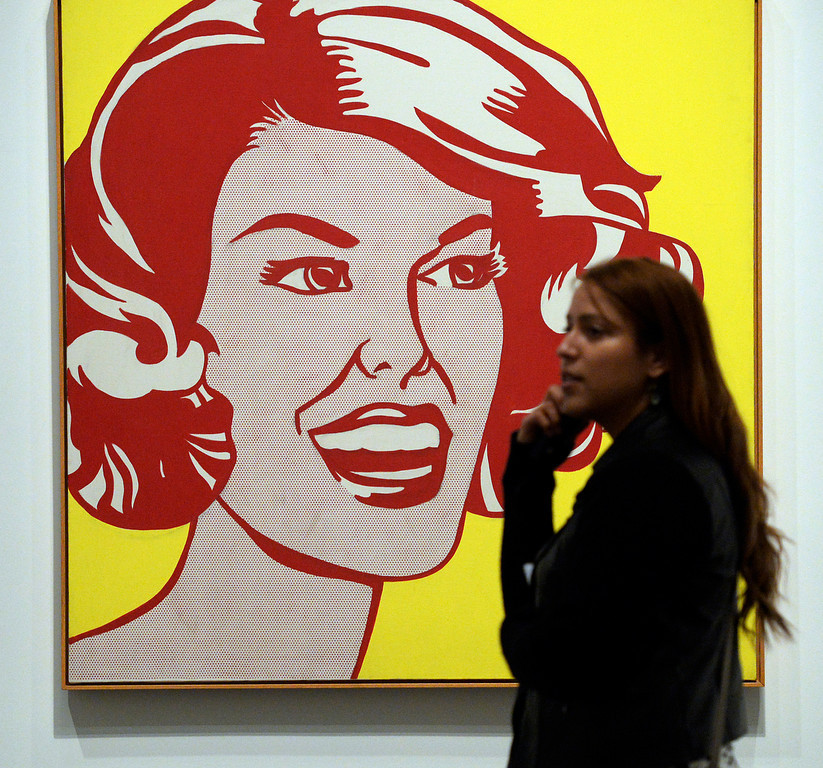 """. Shirly Pezo of Washington D.C.  walks past the Roy Lichtenstein\'s painting \""""Head - Red and Yellow\"""" at  the Denver Art Museum\'s new exhibition, \""""Modern Masters: 20th Century Icons from the Albright-Knox Art Gallery\""""  on Wednesday, March 5,  2014. The exhibit brings to the space some of the art world\'s most recognizable names. Picasso, Van Gogh, Warhol,    (Denver Post Photo by Cyrus McCrimmon)"""