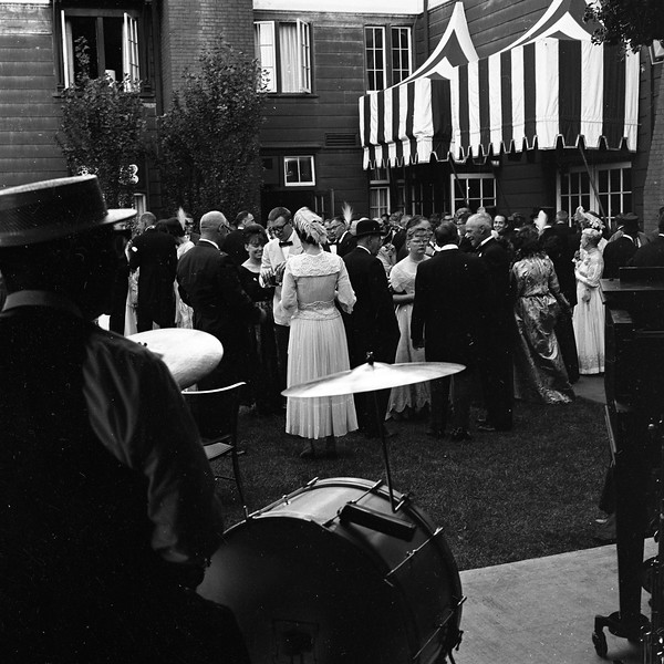 Dressed in turn-of-the-century attire, members of the Horseless Carriage Club of America enjoy a pre-banquet gathering at the Eureka Inn in August 1965. (Times-Standard file photo)