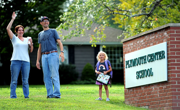 8/28/2019 Mike Orazzi | Staff Candace and Robert Telke with their daughter Nicolina on the first day back to school at the Plymouth Center School on Wednesday morning.