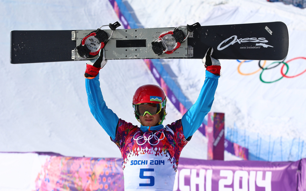 . Zan Kosir of Slovenia celebrates after winning bronze in the men\'s Snowboard Parallel Giant Slalom at Rosa Khutor Extreme Park at the Sochi 2014 Olympic Games, Krasnaya Polyana, Russia, 19 February 2014.  EPA/JENS BUETTNER