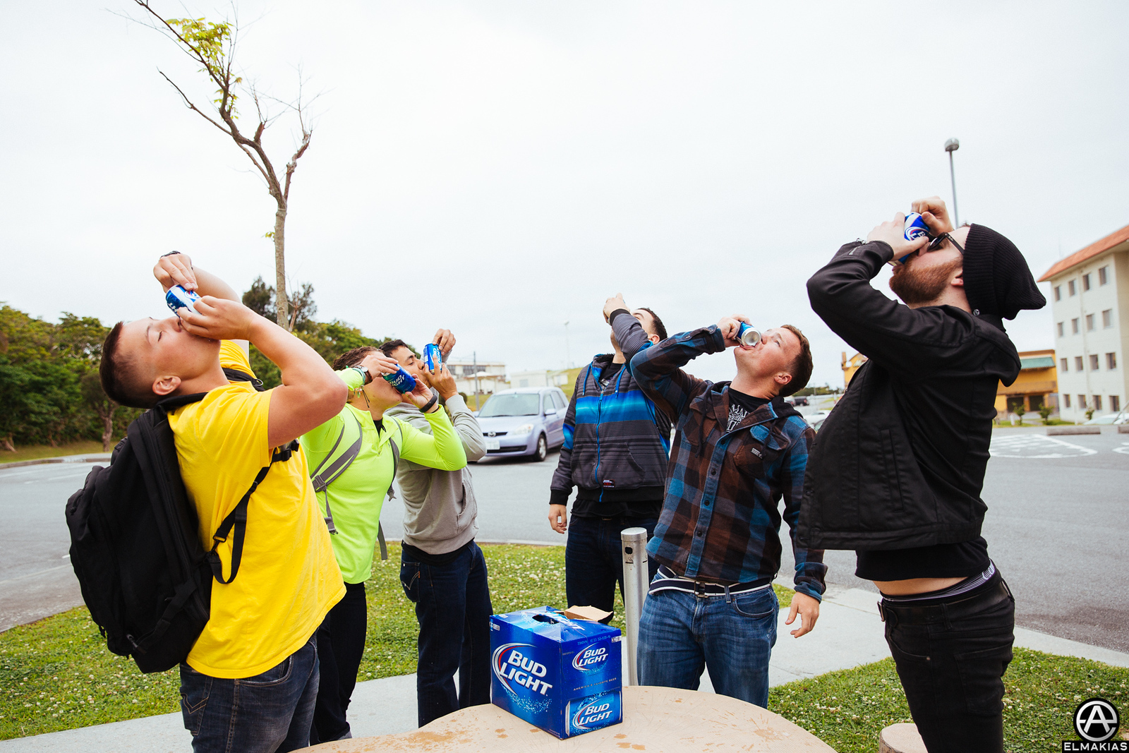 Kevin of A Day To Remember shotgunning a beer with some people on the base