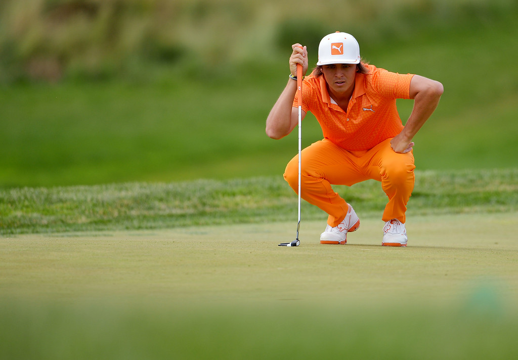 . ARDMORE, PA - JUNE 16:  Rickie Fowler of the United States lines up his putt on the third green during the final round of the 113th U.S. Open at Merion Golf Club on June 16, 2013 in Ardmore, Pennsylvania.  (Photo by Drew Hallowell/Getty Images)