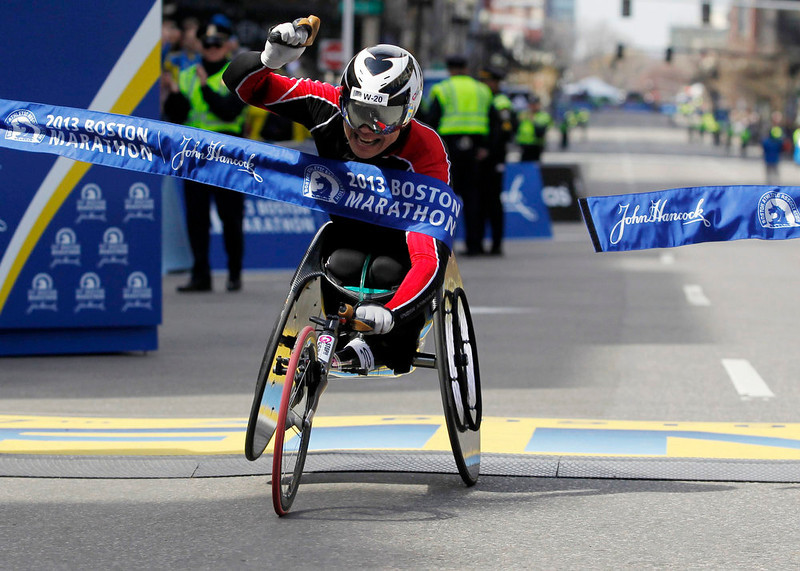 . Hiroyuki Yamamoto of Japan crosses the finish line to win the men\'s wheelchair division of the 117th Boston Marathon in Boston, Massachusetts April 15, 2013. REUTERS/Jessica Rinaldi