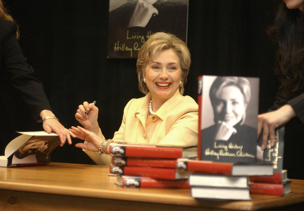 """. Sen. Hillary Rodham Clinton, D-N.Y., autographs copies of her new book, \""""Living History,\"""" at the Barnes & Noble bookstore in New York\'s Rockefeller Center Monday, June 9, 2003. (AP Photo/Mary Altaffer)"""
