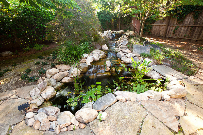 Private zen garden with flagstone walking paths, pond with waterfall feature.