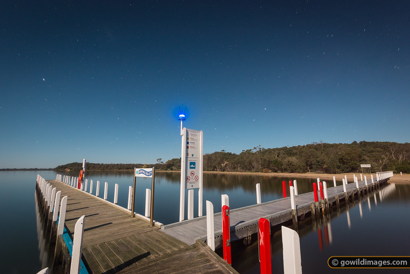 Sperm Whale Head jetty, Point Wilson, The Lakes NP. A long exposure under a full moon on a calm night. The Southern Cross can be seen just to the right of the sign.