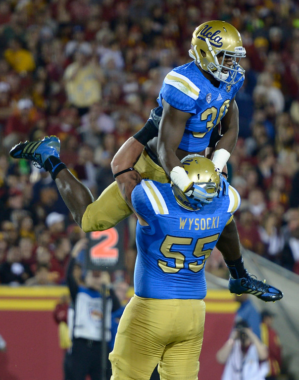 . UCLA Myles Jack celebrates with Ben Wysocki after he scored a TD in the first quarter. UCLA and USC played in a matchup of cross town rivals at the Los Angeles Memorial Coliseum in Los Angeles, CA.  photo by (John McCoy/Los Angeles Daily News)