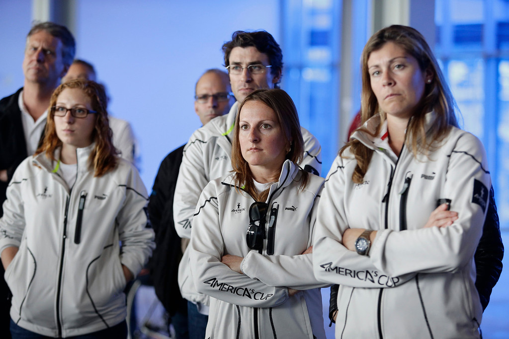""". America\'s Cup staff members, left to right, Briana Billingham, Melanie Roberts and Sarah Hawkins listen in on a press conference on yesterday\'s training tragedy in San Francisco, Calif. on Friday, May 10, 2013. Two-time Olympic medalist, Andrew \""""Bart\"""" Simpson was killed yesterday afternoon when the Artemis Racing team\'s 72-foot catamaran capsized during a practice run for America\'s Cup in the San Francisco Bay. Simpson was trapped beneath the boat and died after efforts to revive him failed.  (Gary Reyes/ Bay Area News Group)"""