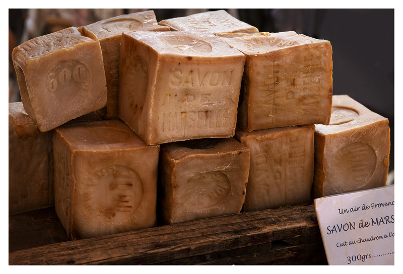 Big blocks of soap from Marseilles. In order to use the soap,  I guess you would have to chip off pieces.