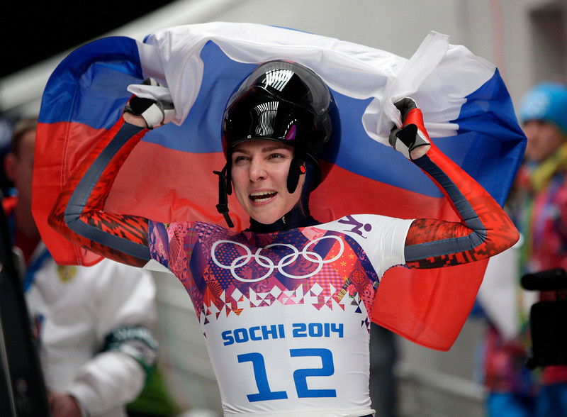 . Elena Nikitina of Russia celebrates her bronze medal win during the women\'s skeleton competition at the 2014 Winter Olympics, Friday, Feb. 14, 2014, in Krasnaya Polyana, Russia. (AP Photo/Michael Sohn)