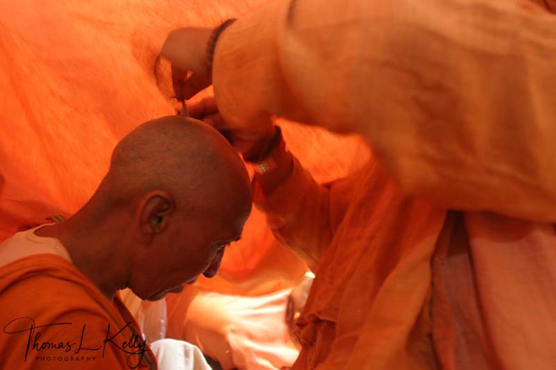 New initiate getting her head shaved.  Ujjain, India.