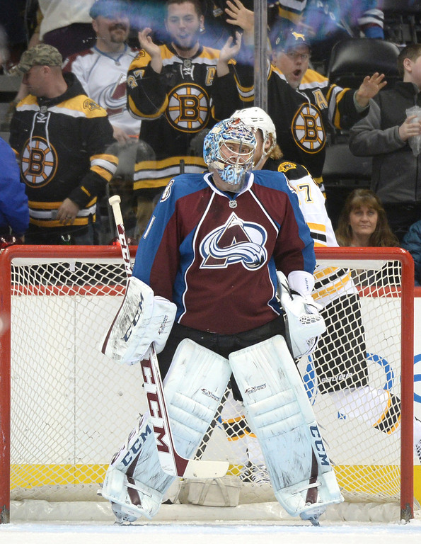 . Boston fans cheered aftr Semyon Varlamov gave up a goal in the first period. The Colorado Avalanche hosted the Boston Bruins at the Pepsi Center Friday night, March 21, 2014. (Photo by Karl Gehring/The Denver Post)