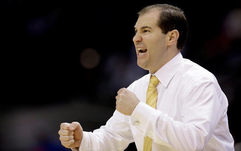 . Baylor coach Scott Drew encourages his team during the first half of a second-round game against Nebraska in the NCAA college basketball tournament Friday, March 21, 2014, in San Antonio. (AP Photo/David J. Phillip)