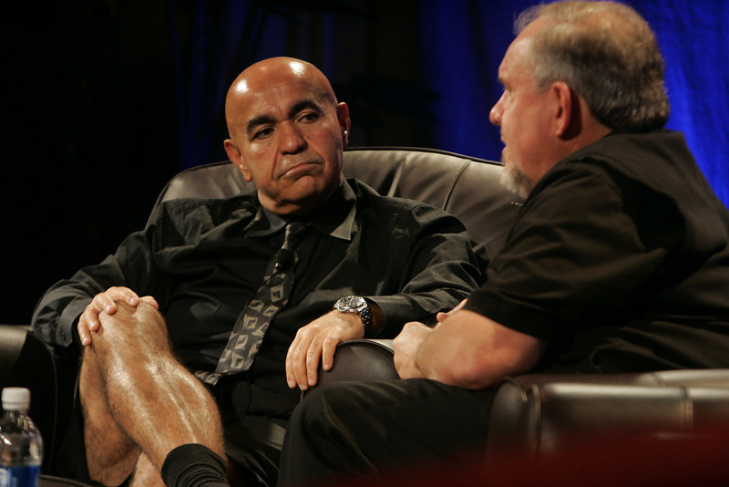 """""""Google's Role in 'Rapid Response to Climate Crisis'"""": Host Kamran Elahian (L, in """"business shorts""""), chair of Global Catalyst Partners and of Beceem Communications; and guest Larry Brilliant, executive director, Google.org"""