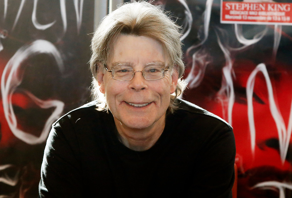 ". FILE - In this Nov. 13, 2013 file photo, author Stephen King poses for the cameras, during a promotional tour in Paris. Fellow author James Patterson had planned to release a book titled, ""The Murder of Stephen King,\"" on Nov. 1, 2016, but decided to withdraw it. In a statement released Thursday, Sept. 22, through Little, Brown and Company, Patterson said he didn�t want to cause King or his family �any discomfort.� (AP Photo/Francois Mori, File)"