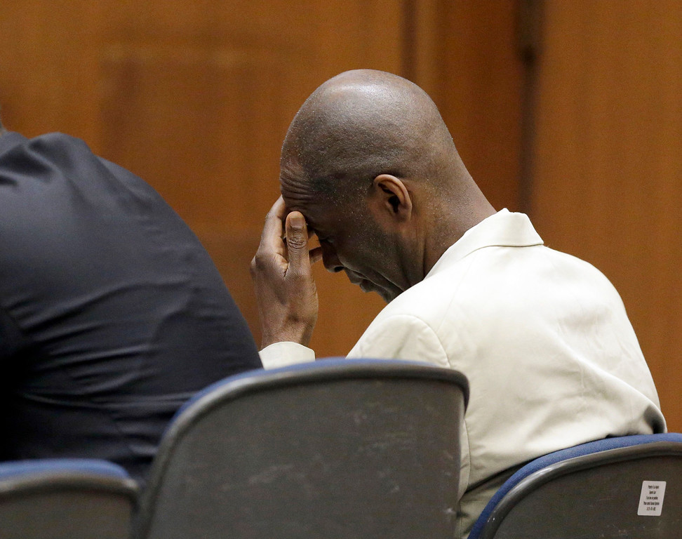 . Actor Michael Jace, right, who played a police officer on television and charged with murdering his wife, listens during closing arguments during his trial at Los Angeles County Superior in Los Angeles Friday, May 27, 2016.(AP Photo/Nick Ut)