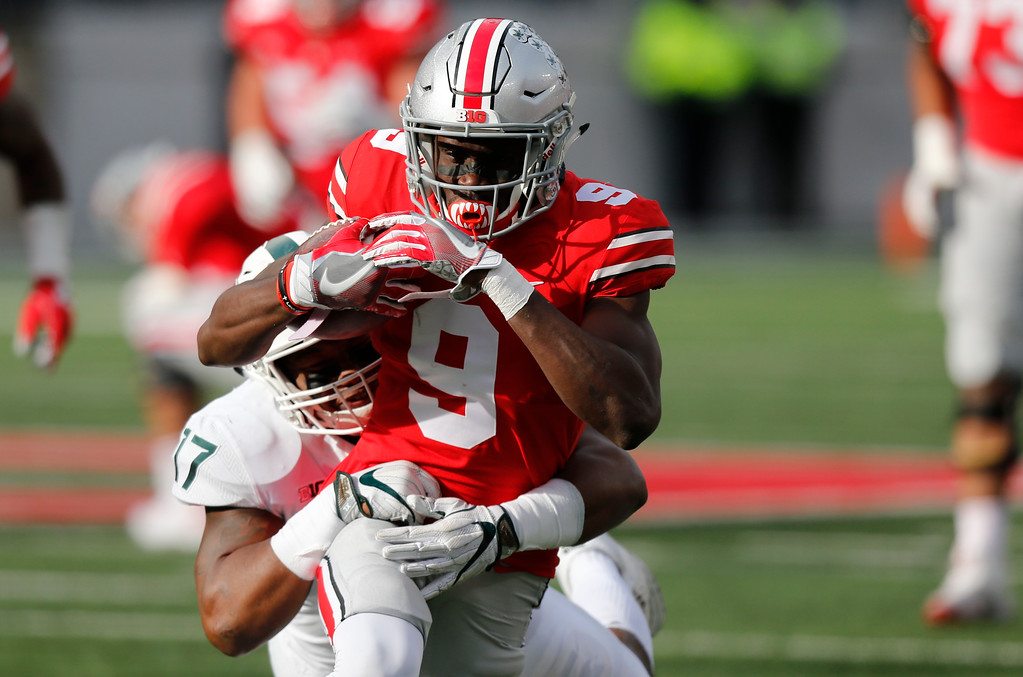 . Ohio State receiver Binjimen Victor runs after a catch as Michigan State linebacker Tyriq Thompson makes the tackle during the second half of an NCAA college football game Saturday, Nov. 11, 2017, in Columbus, Ohio. Ohio State beat Michigan State 48-3. (AP Photo/Jay LaPrete)