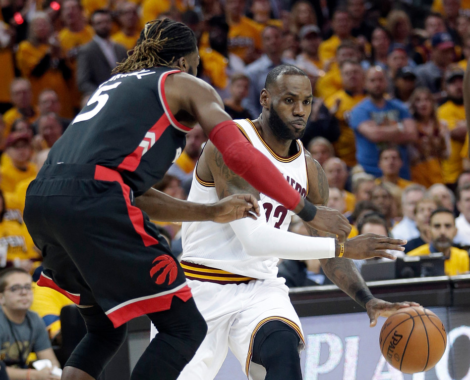 . Cleveland Cavaliers\' LeBron James, right, drives past Toronto Raptors\' DeMarre Carroll in the first half in Game 1 of a second-round NBA basketball playoff series, Monday, May 1, 2017, in Cleveland. The Cavaliers won 116-105. (AP Photo/Tony Dejak)