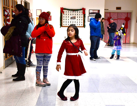 12/13/2019 Mike Orazzi | Staff Wheeler Elementary School student Brittany Gutierrez, 6 1/2, dances while waiting for Santa to arrive at the Plainville Fire Company for the town tree lighting ceremony on Friday evening.
