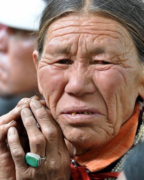 Woman listening to the Dalai Lama speak.