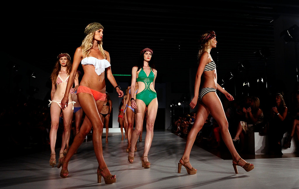. Models wear creations from TCN during a 080 Barcelona fashion show in Barcelona, Spain, Wednesday, July 10, 2013.  (AP Photo/Manu Fernandez)