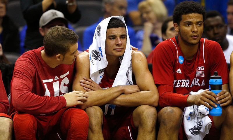 . Tai Webster #0 of the Nebraska Cornhuskers sits on the bench with teammates after a play in the first half against the Baylor Bears during the second round of the 2014 NCAA Men\'s Basketball Tournament at AT&T Center on March 21, 2014 in San Antonio, Texas.  (Photo by Tom Pennington/Getty Images)