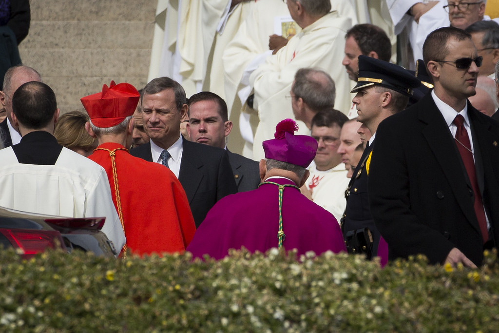. At left, Supreme Court Chief Justice John Roberts greets Cardinal Donald Wuerl, Archbishop of Washington, after exiting the Basilica of the National Shrine of the Immaculate Conception at the end of the funeral for late Supreme Court justice Antonin Scalia, February 20, 2016 in Washington, DC. Scalia, who died February 13 while on a hunting trip in Texas, laid in repose in the Great Hall of the Supreme Court on Friday and his funeral service will be at the basilica today.  (Photo by Drew Angerer/Getty Images)