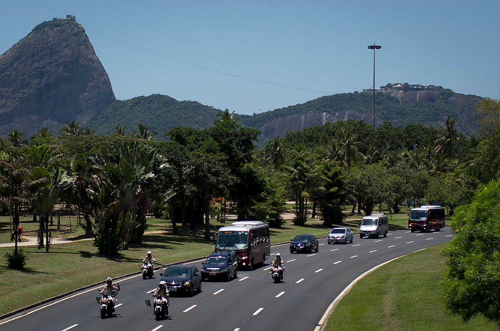 . A motorcade escorts a hearse to the airport carrying the remains of Brazilian architect Oscar Niemeyer, in Rio de Janeiro, Brazil, Thursday, Dec. 6, 2012.  Niemeyer, 104, the groundbreaking architect who designed Brazil\'s futuristic capital and much of the United Nations complex, died Wednesday night in Rio de Janeiro, the seaside city where he was born and where his remains will be buried after he is honored with a service in Brasilia at the presidential palace he designed. (AP Photo/Felipe Dana)