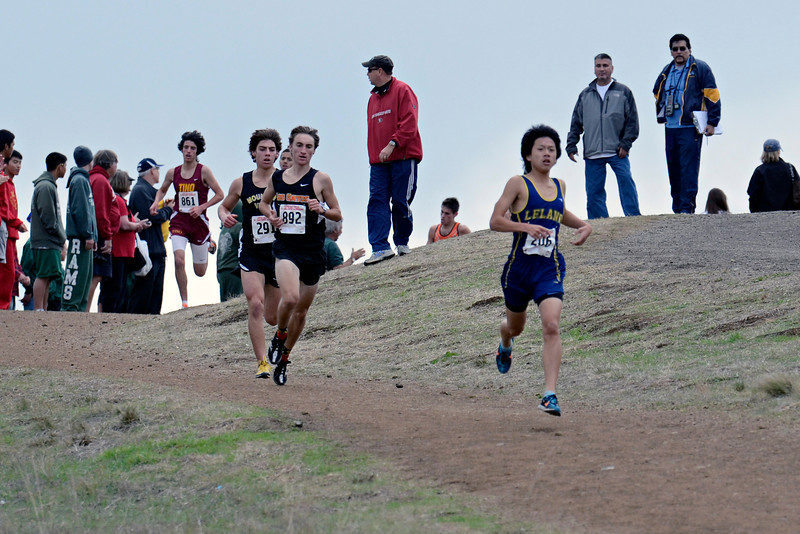After the gun went off, it didn't take Richard Ho of Leland long to put himself in the lead, followed closely by Grant Foster of Los Gatos. They were the two odds-on favorites to win; Ho had the fastest CCS time at Crystal to date, a 15:10.