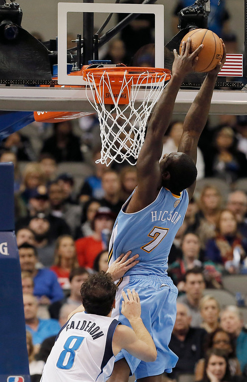 . Denver Nuggets forward J.J. Hickson (7) dunks as Dallas Mavericks\' Jose Calderon (8) defends during the second half of an NBA basketball game Monday, Nov. 25, 2013, in Dallas. Denver won 110-96. (AP Photo/Brandon Wade)
