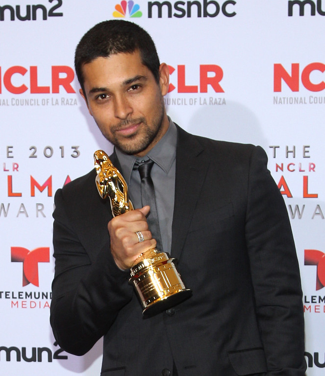 . Wilmer Valderrama poses with the outstanding social activism award backstage at the NCLR ALMA Awards at the Pasadena Civic Auditorium on Friday, Sept. 27, 2013, in Pasadena, Calif. (Photo by Paul Hebert/Invision/AP Images)