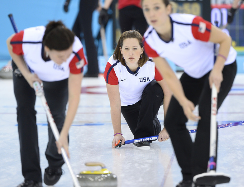 . US Debbie McCormick (C) throws the stone during the women\'s curling round robin session 2 match between Russia and USA at the Ice Cube curling centre in Sochi on February 11, 2014 during the 2014 Sochi winter Olympics. (JONATHAN NACKSTRAND/AFP/Getty Images)