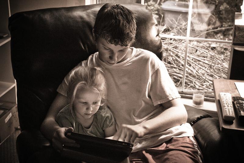Chloe and Joshua play on their iPad - May 2011