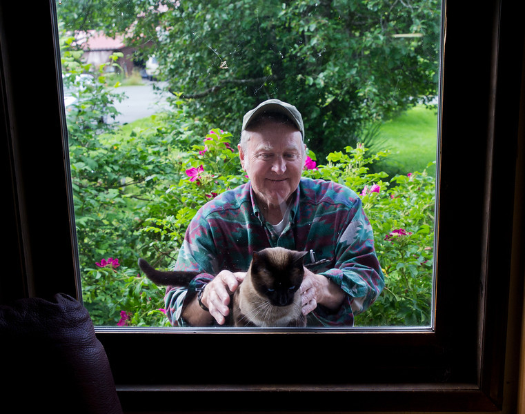 Pat showing off Mao in the window.