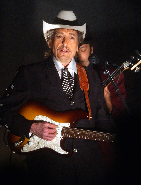 """. Bob Dylan performs \""""Cry A While\"""" at the 44th annual Grammy Awards, Wednesday, Feb. 27, 2002, in Los Angeles. (AP Photo/Kevork Djansezian)"""