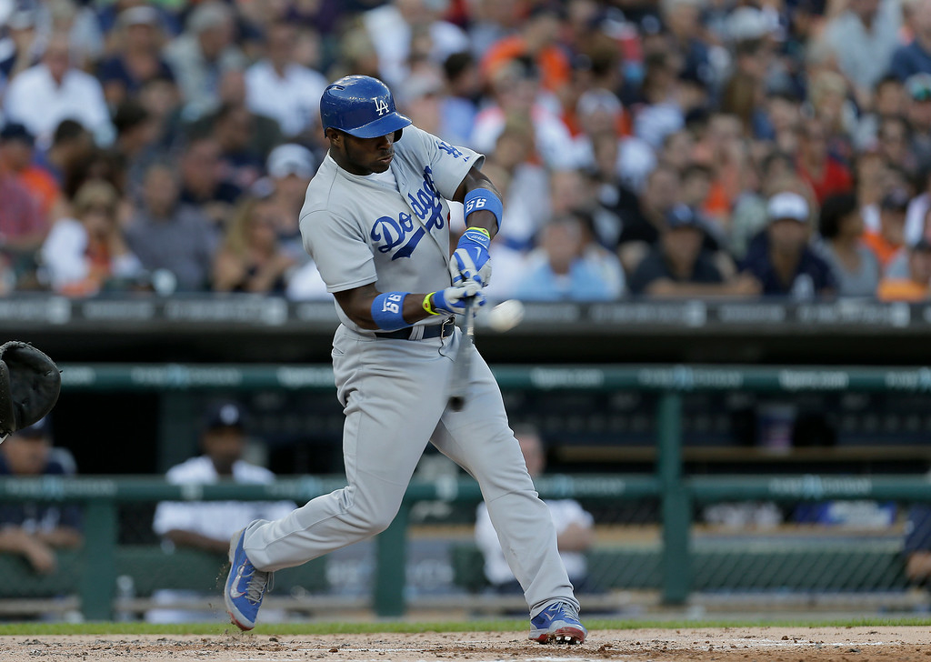 . Los Angeles Dodgers Yasiel Puig bats against the Detroit Tigers in the second inning of a baseball game in Detroit, Tuesday, July 8, 2014. (AP Photo/Paul Sancya)