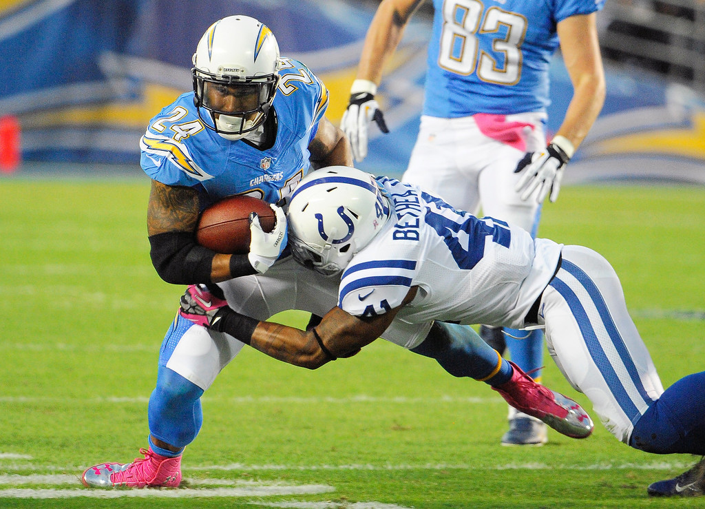 . San Diego Chargers running back Ryan Mathews, (24) is brought down by Indianapolis Colts free safety Antoine Bethea, right during the first half of an NFL football game Monday, Oct. 14, 2013, in San Diego. (AP Photo/Denis Poroy)