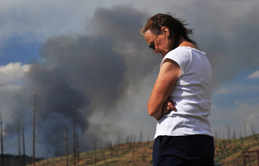 . CONIFER, CO. - June 19: Evacuee Sally Desmarteau is watching the Lime Gulch Fire in Jefferson County from North Falk Volunteer Fire Station. Conifer, Colorado. June 19, 2013. A wildfire burning in south Jefferson County forced residents to evacuate their homes. (Photo By Hyoung Chang/The Denver Post)