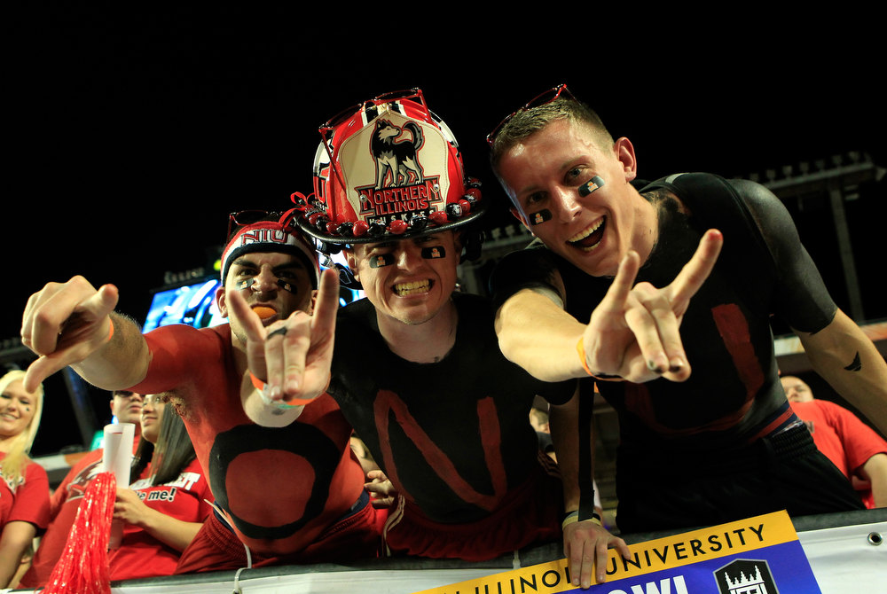 . Fans of the Northern Illinois Huskies support their team against the Florida State Seminoles during the Discover Orange Bowl at Sun Life Stadium on January 1, 2013 in Miami Gardens, Florida.  (Photo by Chris Trotman/Getty Images)