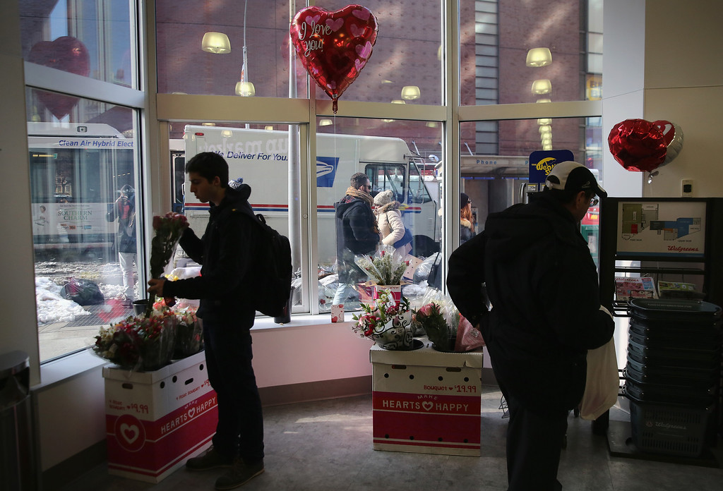 . Customers choose cards and gifts at Walgreen\'s on Valentine\'s Day, February 14, 2014 in New York City. People made last-minute purchases for loved ones and special friends.  (Photo by John Moore/Getty Images)