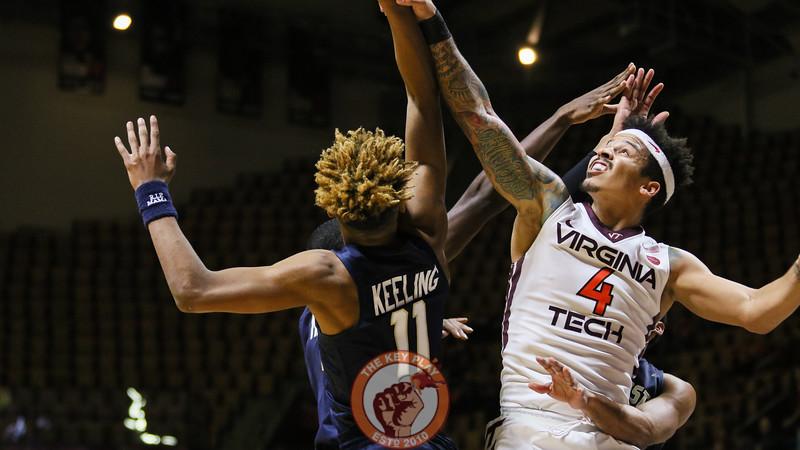 Seth Allen attempts a shot while triple teamed. (Mark Umansky/TheKeyPlay.com)