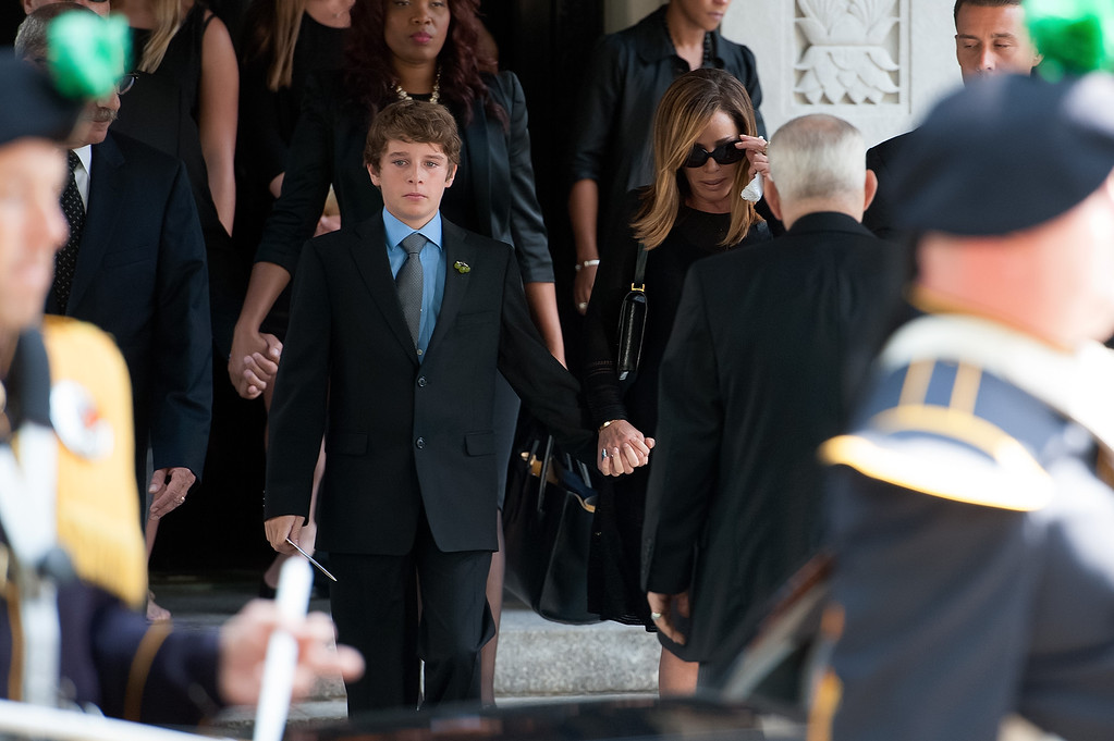 . Melissa Rivers (center R) and son Cooper Endicott (center L) attend the Joan Rivers memorial service at Temple Emanu-El on September 7, 2014 in New York City. Rivers passed away on September 4, 2014 after suffering respiratory and cardiac arrest during vocal cord surgery on August 28, 2014.  (Photo by D Dipasupil/Getty Images)